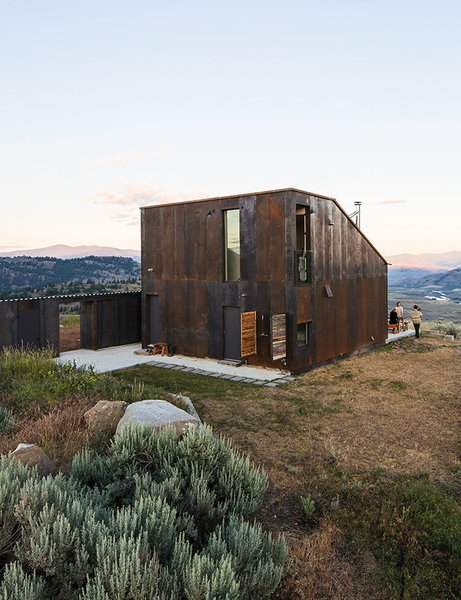 Architect Jesse Garlick's rural Washington vacation home references its rugged surroundings. The steel cladding has developed a patina similar to the ochre-red color of bedrock found in the area.