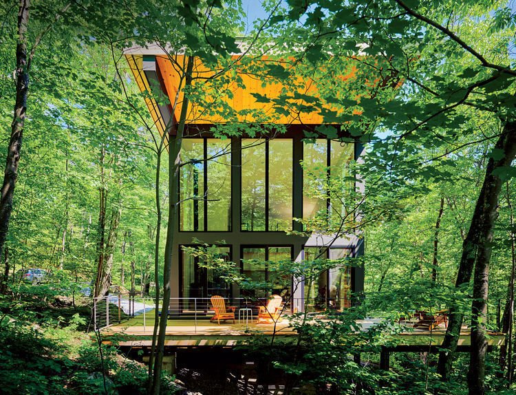 Exterior, Cabin Building Type, and Shed RoofLine A cantilevered cabin designed by R D Gentzler blends into the forest, even as it hovers above a 20-foot drop-off. Its south face is almost entirely glass, but a roof canopy limits solar gain.   Cabins & Hideouts from Gentzler's Cantilevered Cabin