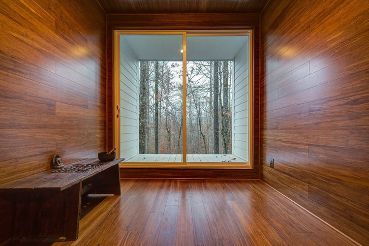 The room is clad entirely in bamboo and frames a view of the surrounding deciduous forest.   Gordon Cabin