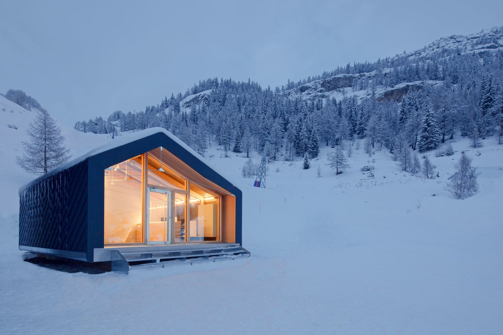 Exterior, Cabin Building Type, House Building Type, Prefab Building Type, and Glass Siding Material #prefab #house #modern #architecture #cabin #snow #smallspaces   Outdoors