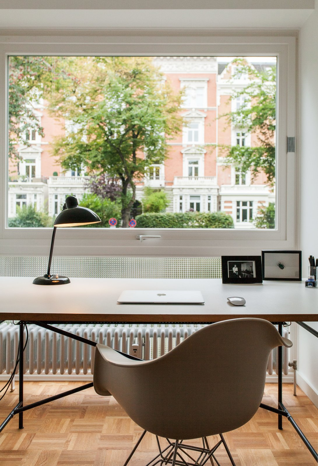 Office, Lamps, Chair, Medium Hardwood Floor, and Desk Home office  Best Photos from Eames Molded Chairs