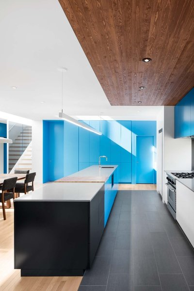 #interior #design #interiordesign #blue #kitchen #whitecountertop #countertop #woodfloor #black #stairs #woodtable #stove #woodceiling #lighting #kitchenlighting #storage #modern #stonegray #quartz #benjaminmoore #rockymountain #sky #quebec #renovation #naturehumaine #cabinets  36+ Interior Color Pop Ideas For Modern Homes