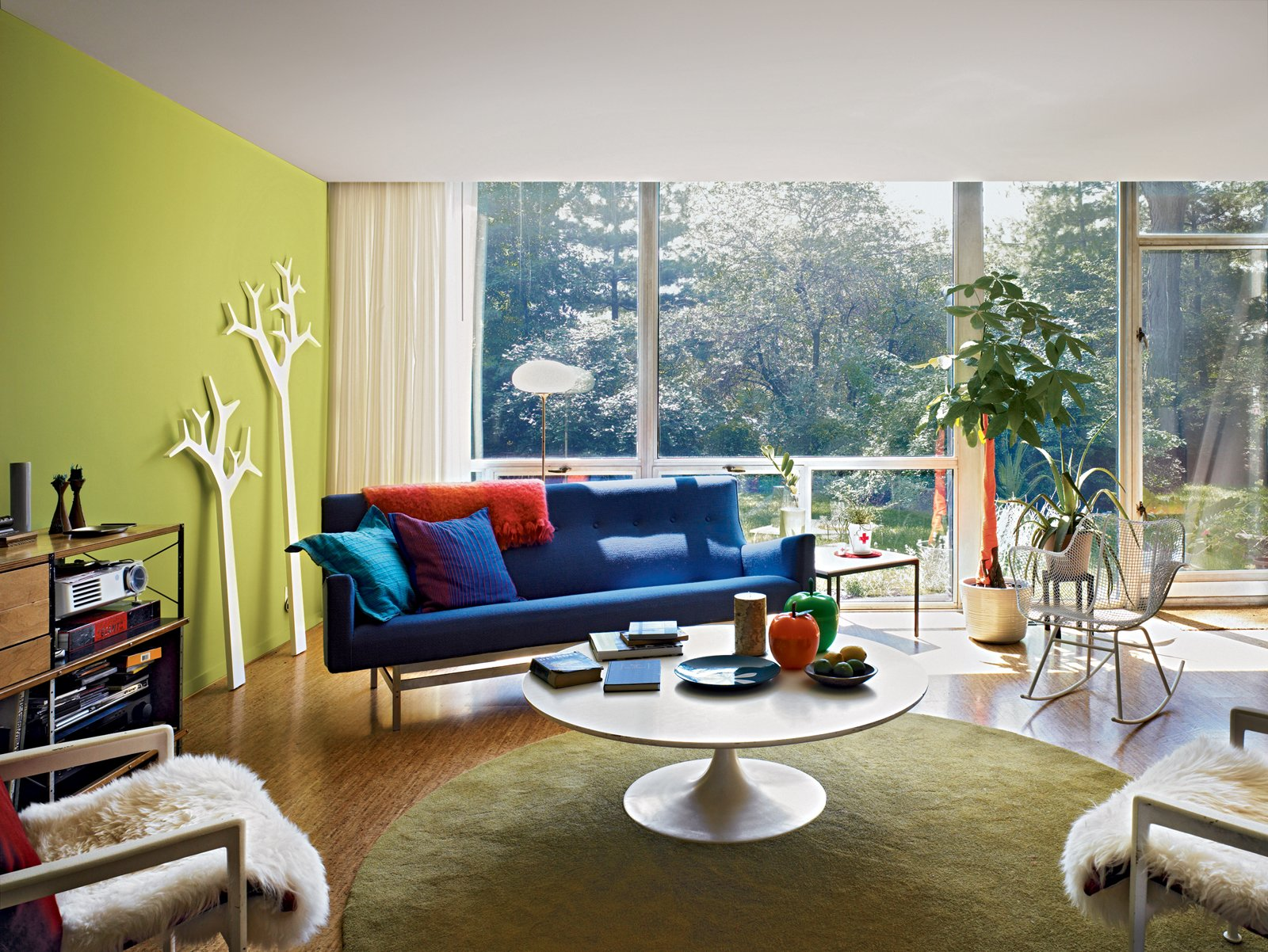 #interior #design #interiordesign #modern #livingroom #color #designwithcolor #rockingchair #green #blue #sofa #rug #orange #red #plants #stereo #treecoathangers #michaelyoung #katrinpetursdottir #foliage #outside #exterior #furchair #vintage #furniture  36+ Interior Color Pop Ideas For Modern Homes
