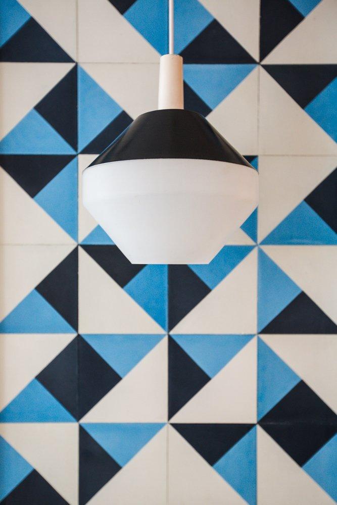 #pendant #amsterdammodern  #blackspunaluminum #vintage #pilastro #diamondmilkglass #lighting #interior #modern #tile  60+ Modern Lighting Solutions by Dwell
