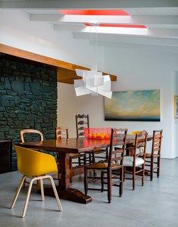 #interior #modern #inside #design #interiordesign #walnutpanels #red #yellow #color #minimalstspace #pendant #bigbang #foscarini #eames #wood #diningroom #diningarea #belair #ranchstyle #fruitbowl #wallart #chandelier #naturallight #seatingdesign #seating
