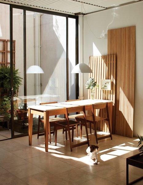 #interior #dining #modern #table #diningarea #woodtable #glassdoor #carrara #net #architect #alejandrosticotti #boardchair  #travertinetiles #reclaimedmarble #marbletop