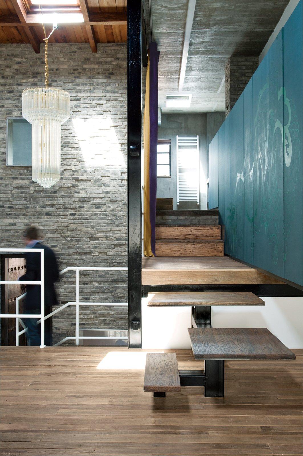 #lightingdesign #lighting #stairs #chandelier #Shanghai #China #EdoardoAllegranti #interior #indoor #inside #teal #brick #modern #traditional #wood   60+ Modern Lighting Solutions by Dwell