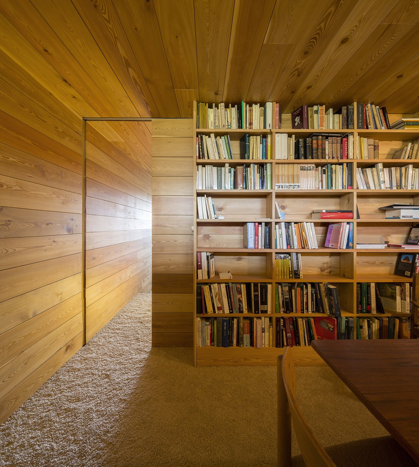#storage #modern #minimal #structure #function #library #wood #panels #bookshelves #books #dynamic #detail #slidingdoor #vacationhome #Spain    bookcase
