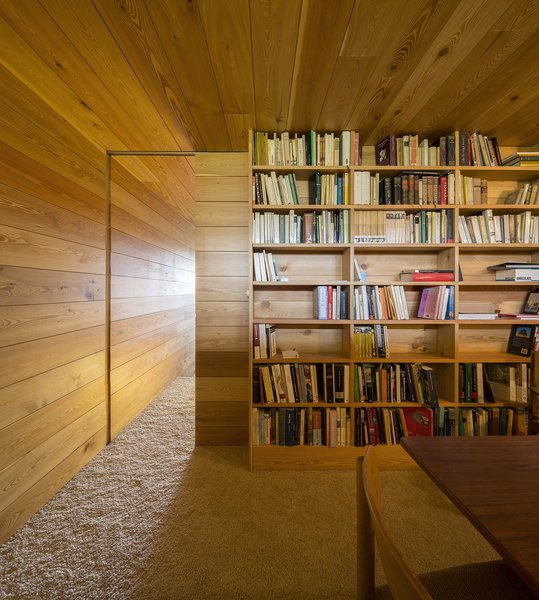 #storage #modern #minimal #structure #function #library #wood #panels #bookshelves #books #dynamic #detail #slidingdoor #vacationhome #Spain