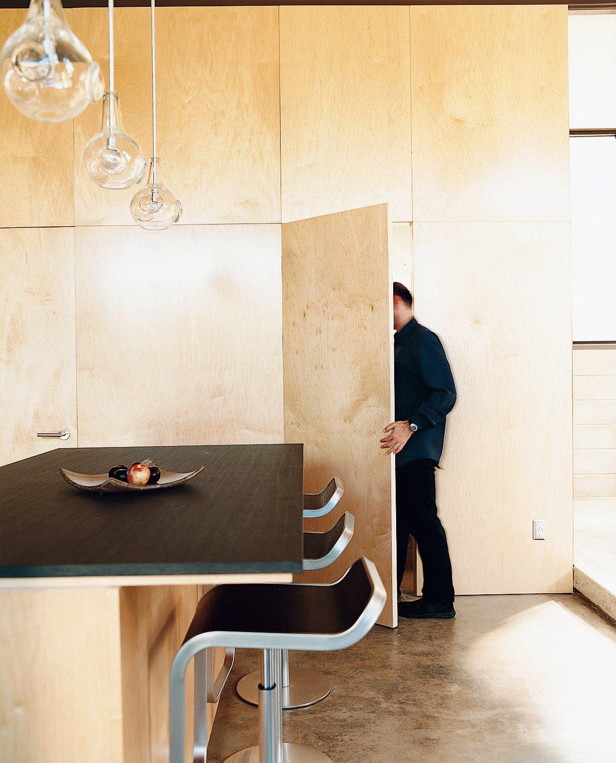 #storage #cabinetry #kitchen #dining #door #minimal #modern #interior #lighting #counter #stools #1960s #SantaMonica #California #GlennResidence #RayKappe  60+ Modern Lighting Solutions by Dwell