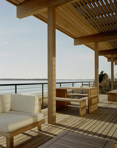 #beachhouses #exterior #outside #outdoors #modern #midcentury #landscape #deck #seating #wood #panels #view #porch #indooroutdoorliving #TamarkinResidence #TamarkinCo.