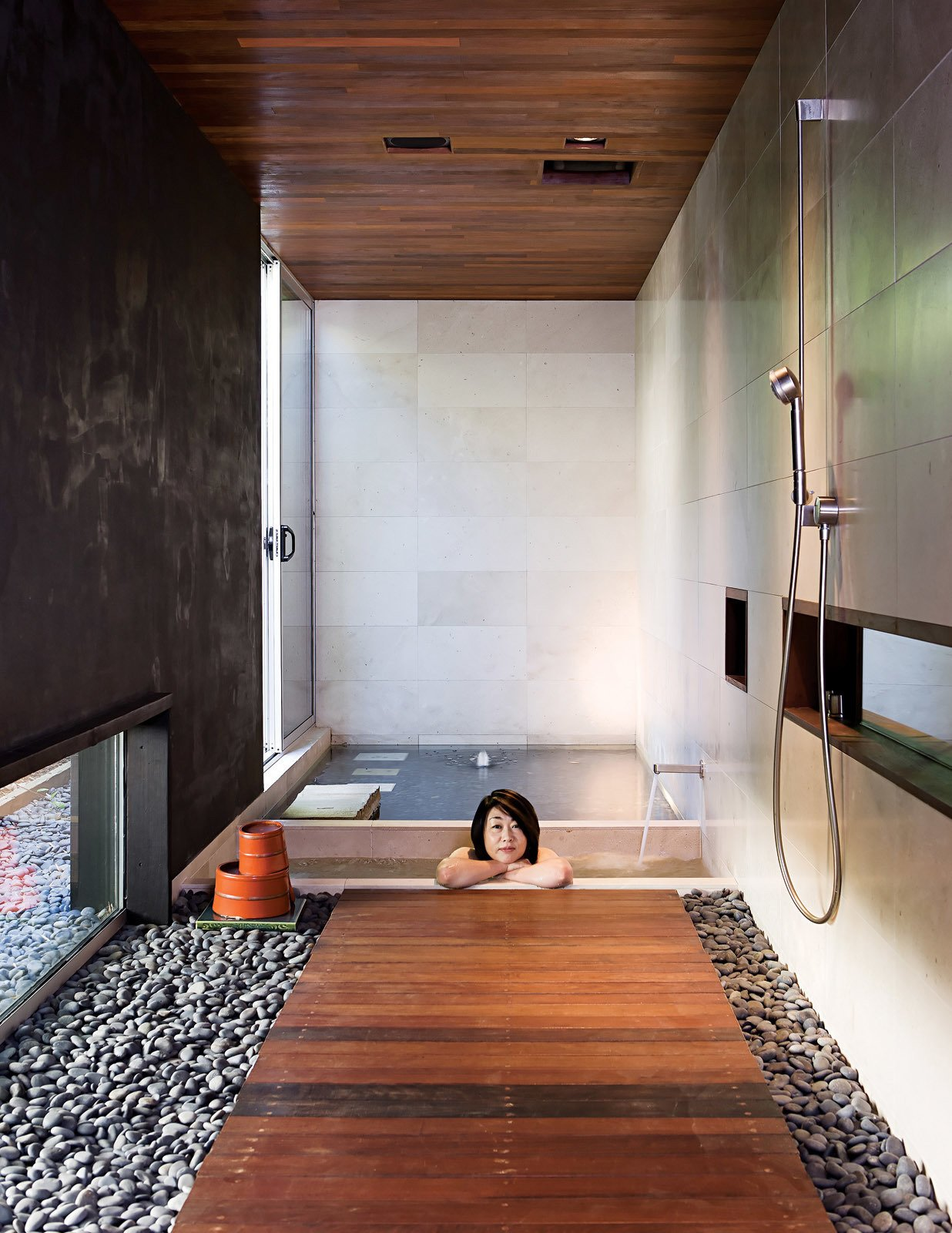 Bath Room, Ceramic Tile Wall, and Medium Hardwood Floor #modern #moderndesign #bath&spa #bathroom #interior #shower #pebblewalkway #bath #japanese #japanesestyle #soakingtub #woodflooring #dornbracht   Best Photos from Bath & Spa Intrigue