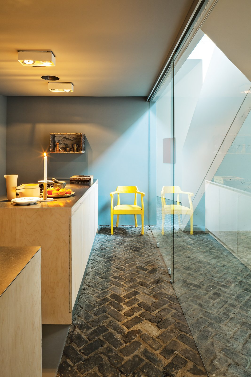 #color #blue #kitchen #chair #brick #Antwerp #Belgium #BartLens  36+ Interior Color Pop Ideas For Modern Homes