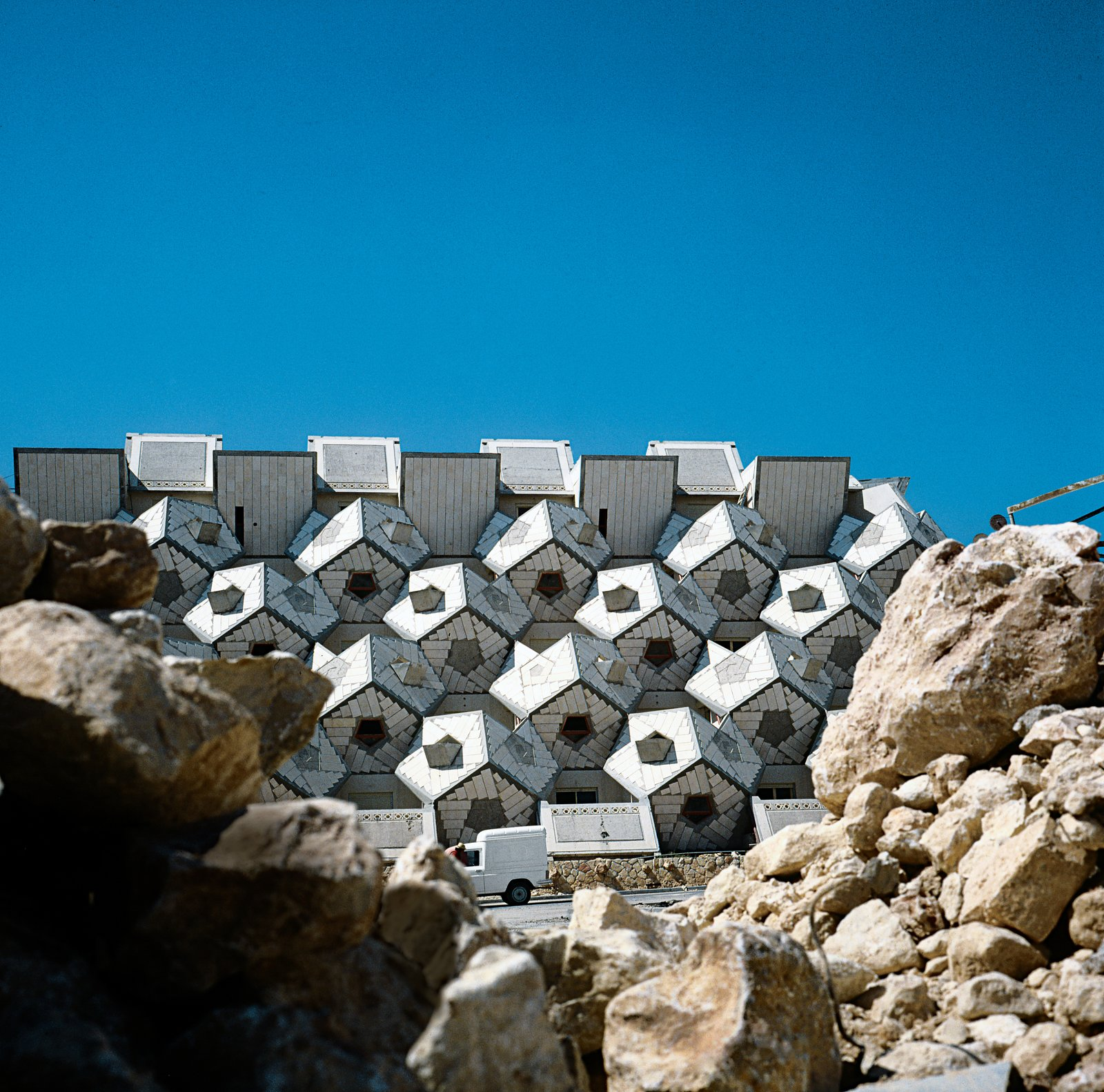 """""""I hope that the design will stimulate architects to break away from strictly cubic structures,"""" Hecker wrote   in a 1980 manifesto. Photo by Zvi Hecker.  Geometric Housing Complex in Jerusalem  by Diana Budds"""