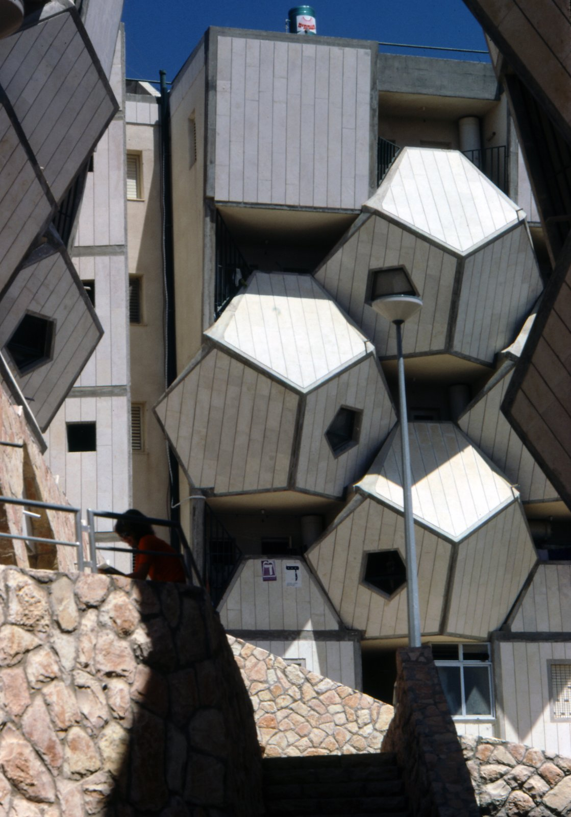 Hecker also argues that the structure's form helps it to adapt to hilly and irregular terrain. Photo by Zvi Hecker.  Geometric Housing Complex in Jerusalem  by Diana Budds