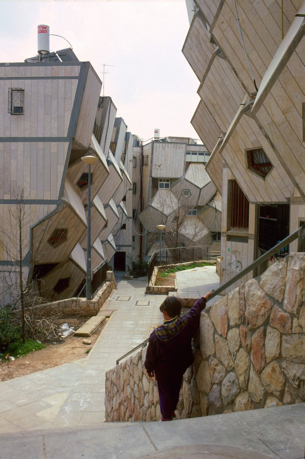 Hecker argues that the use of dodecahedrons and the pentagon-shaped walls helps to enclose a relatively large volume with less surface area than a rectangular prisim. Photo by Zvi Hecker.  Geometric Housing Complex in Jerusalem  by Diana Budds