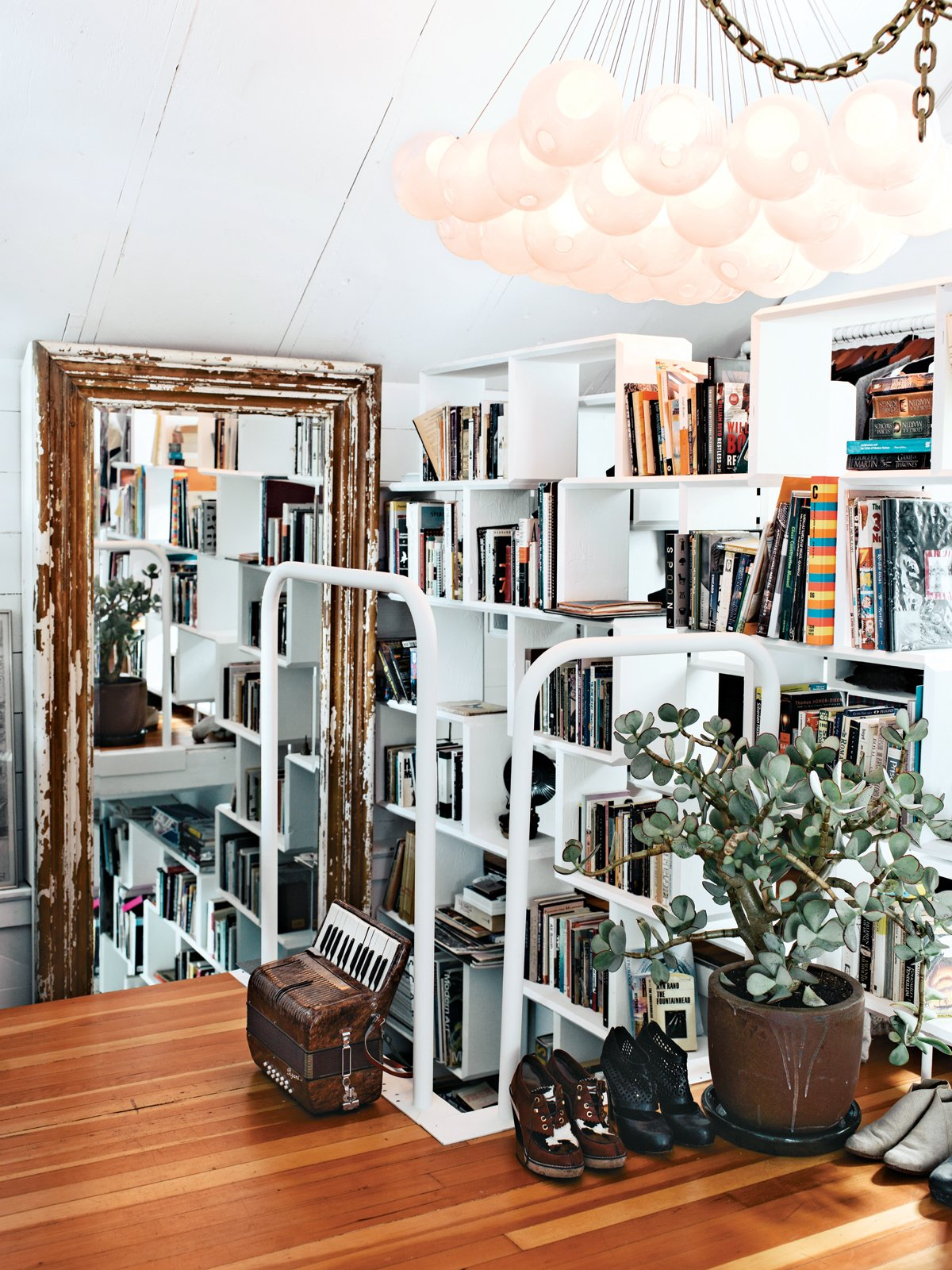 """Many of my pieces are first-runs from Bocci, so I am the first to figure out if something is wrong [with the design]. In the bedroom, we have an early 28 chandelier; we used glass fading from white to clear for the first time, which gives it an eerie luminescence.""  30+ Modern Homes With Libraries by Matthew Keeshin from Dwell Houses, In Their Own Words"