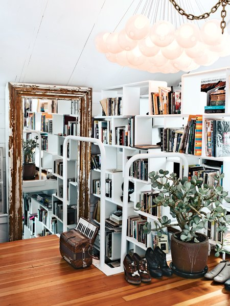 """""""Many of my pieces are first-runs from Bocci, so I am the first to figure out if something is wrong [with the design]. In the bedroom, we have an early 28 chandelier; we used glass fading from white to clear for the first time, which gives it an eerie luminescence.""""  30+ Modern Homes With Libraries by Matthew Keeshin"""