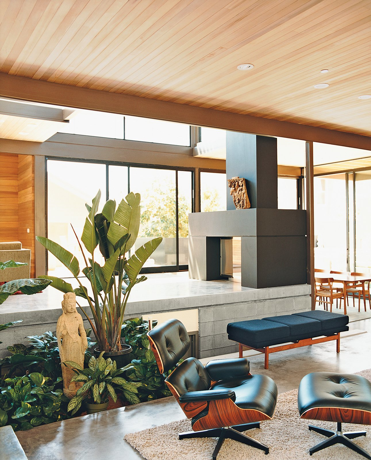 Living, Recliner, Concrete, and Two-Sided The lower living space on the ground floor of a Los Angeles, California, home features an EcoSmart fireplace fueled by denatured alcohol. Read the full article here.  Best Living Concrete Recliner Photos from LEEDing the Way