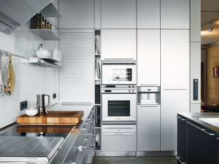 "Typography guru Erik Spiekermann and his wife, designer Susanna Dulkinys, hate clutter. That's why they love the super-sleek Berlin domicile they constructed to have just the right lines—and a host of energy-saving features behind the scenes. The stainless-steel Bulthaup kitchen ""cost as much as a small house,"" said Spiekermann, though he did get a discount: Bulthaup is one of his clients."