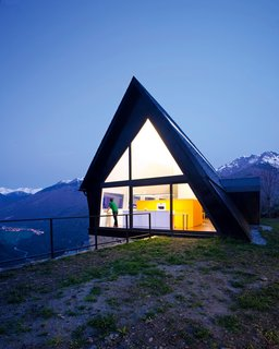 Updating the A-frame of yore, this home's liberal use of windows makes the most of panoramic views spanning two valleys. Catalonia, Spain. Cadaval & Sola-Morales from the book Rock the Shack, Copyright Gestalten 2013.