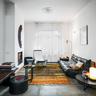 For the living room of their house in Genk, Belgium, Michaël Verheyden and Saartje Vereecke mixed furnishings of their own design with classic pieces. Their G55 sling chair and Michel Ducaroy's Togo sofa for Ligne Roset are both clad in black leather.
