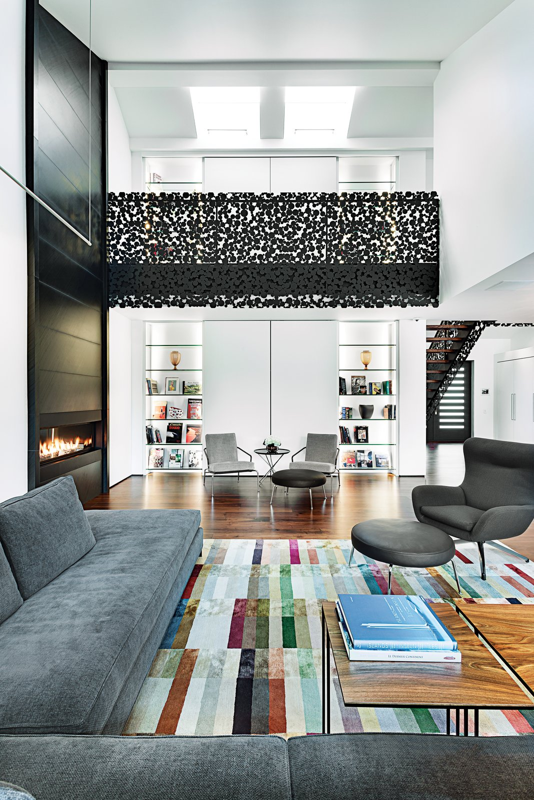 """The centerpiece of the addition is a new anthracite """"iron lace"""" staircase, which was loosely inspired by wooden circle motifs found in the house's original entryway.  127+ Inspiring Interior Ideas from A Sophisticated Renovation in Montreal"""
