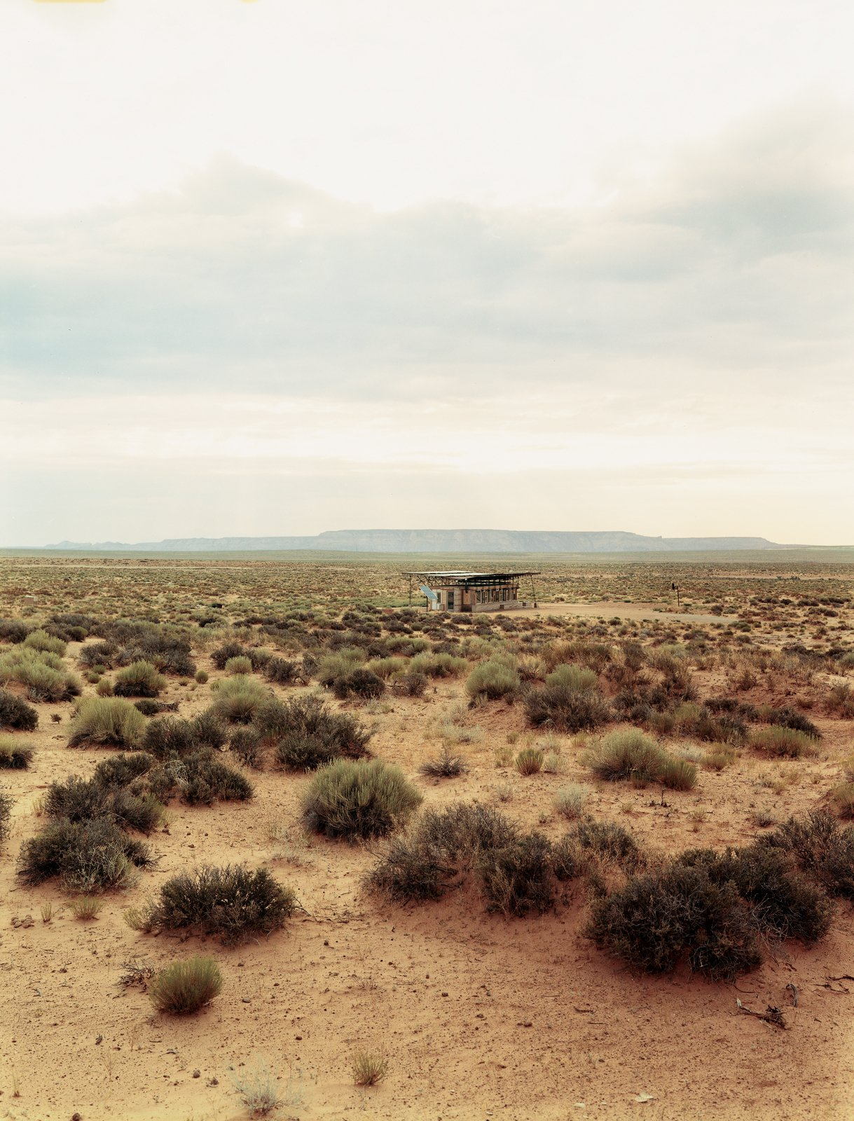 Outdoor and Desert Architect Hank Louis worked with Navajo tribe elders to secure a 66-year lease on a half-acre lot in the middle of Bluf, Utah, for Rosie Joe and her children.  Photo 4 of 8 in No Grid in Sight