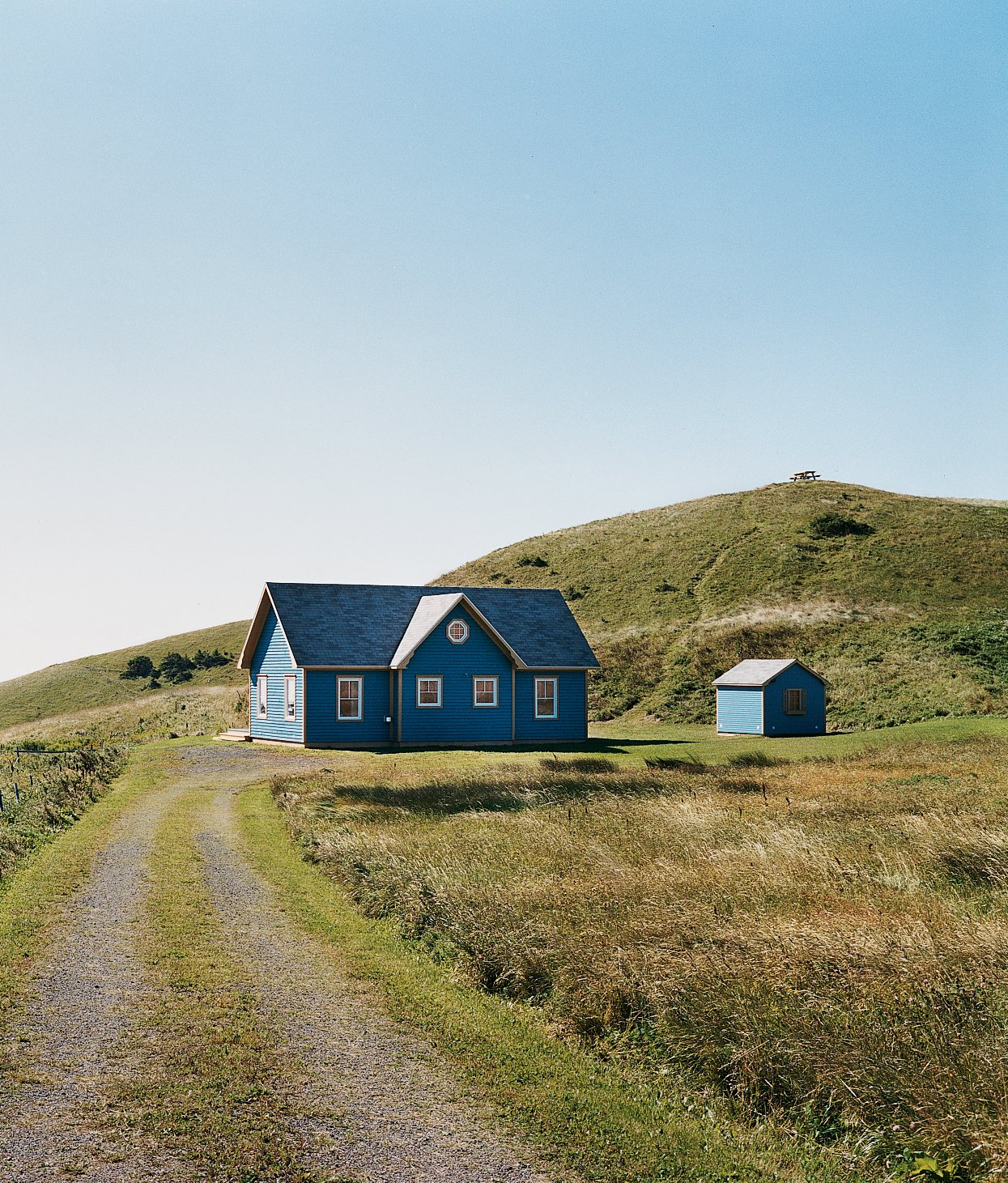 """Exterior, House Building Type, Wood Siding Material, and Shingles Roof Material A small deck off the back of the main house is protected from the wind and supported by a small grassy mound.  Search """"arch support"""" from Blue in the Facade"""