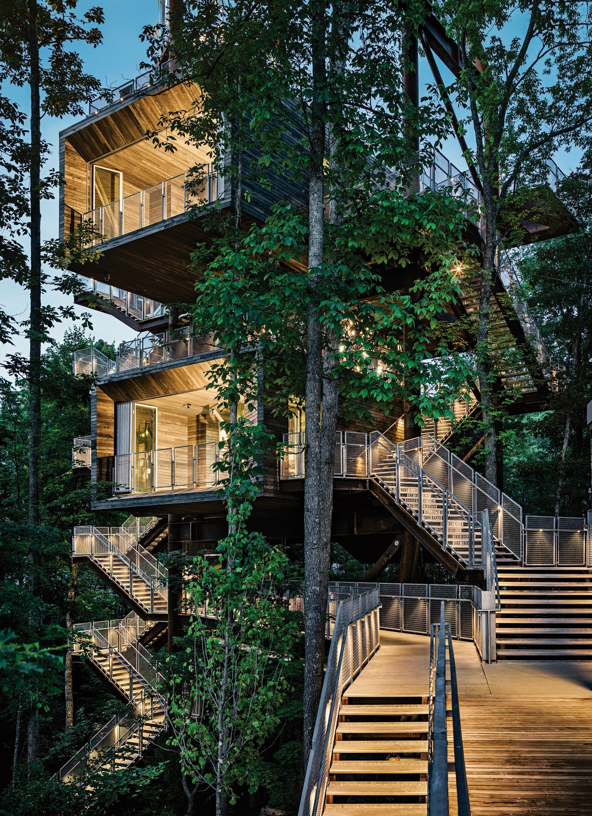 Exterior, Treehouse Building Type, Flat RoofLine, Wood Siding Material, House Building Type, and Cabin Building Type Visitors learn about energy and water conservation as they climb outdoor staircases that lead from the forest floor to the 125-foot-high rooftop rising above the leaf canopy.  Sustainability Treehouse by Diana Budds
