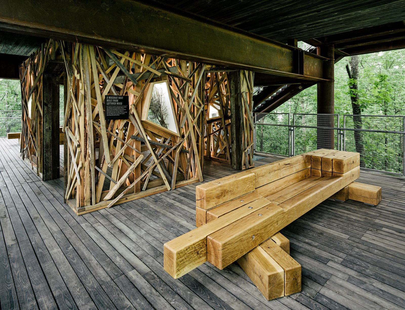 A bench offers a place to rest and take in the surrounding tree canopy. Creating opportunities for contemplation is another key element of the structure's design.  Sustainability Treehouse by Diana Budds