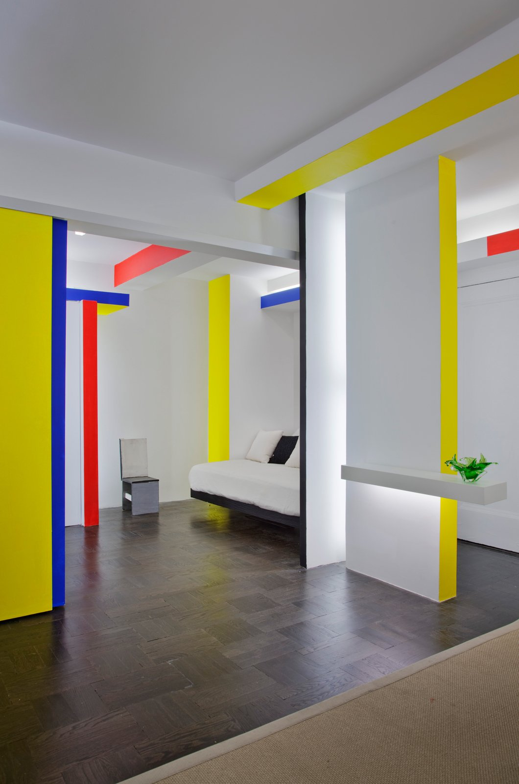 Taking cues from Piet Mondrian's iconic Broadway Boogie Woogie painting, architect and critic Joseph Giovannini recasts a New York City studio apartment.  Photo 17 of 25 in 25 Bold Ways to Decorate with Yellow from Primary Colors in Home Design