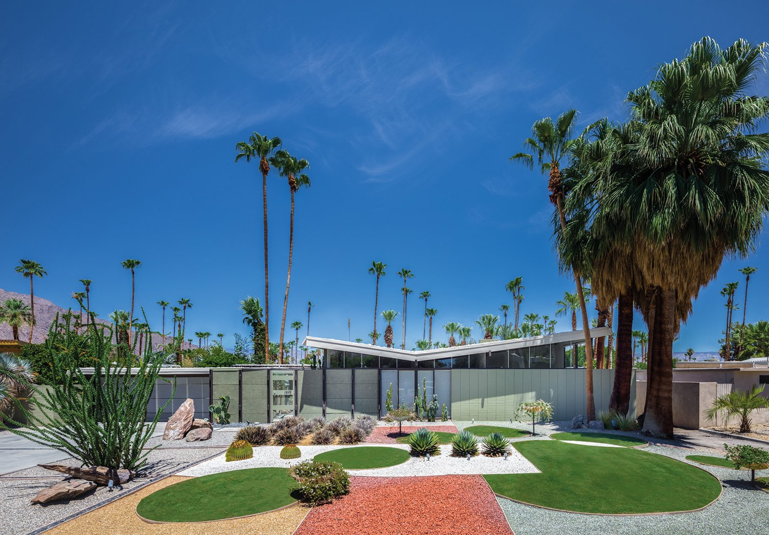 Exterior, Mid-Century Building Type, House Building Type, and Butterfly RoofLine Krisel was also known for his boldly modern approach to landscape. The Menrad residence, shown here, features a distinct geometric design. The architect, working in the harsh Palm Springs climate, relied on hardscape elements—setting a precedent for drought-tolerant landscape design.  A Crash Course in Palm Springs Architecture from Midcentury Lovers: You Can Thank This Architect for Transforming Palm Springs Into a Modernist Hotbed