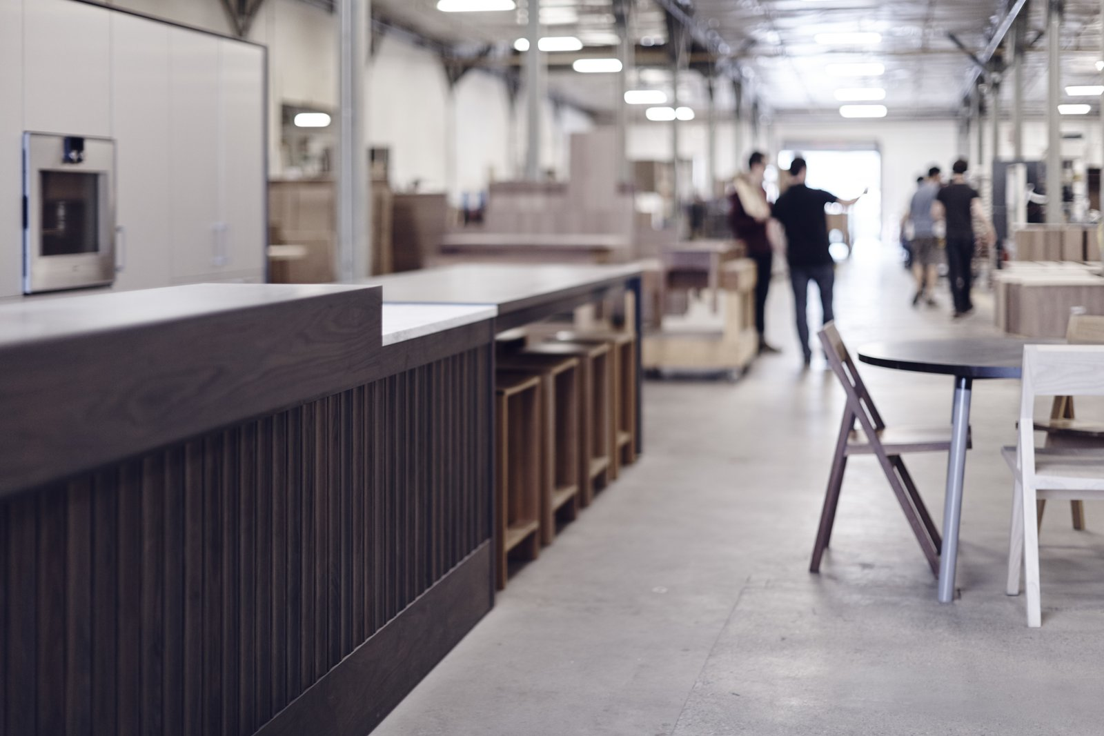 Having the test kitchen in such close proximity to the production floor—literally sharing the same space—allows Henrybuilt to implement improvements quickly and effectively. Though this requires a little extra cleaning, it emphasizes the connection between the people building the product and those actually using it.  Photo 3 of 8 in What Goes On Behind-the-Scenes at Henrybuilt's Seattle Test Kitchen