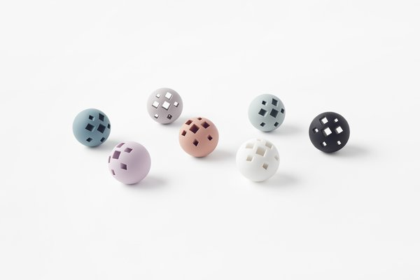 Naturally, a collection like this would have to include a toy ball. An array of square holes are optimal for hiding snacks and bouncing around.