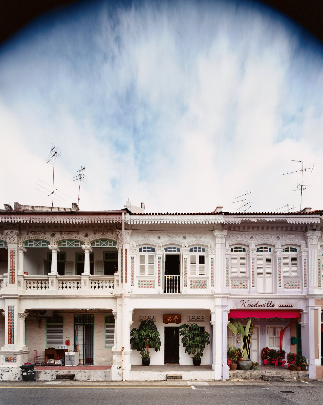 """""""Shophouses brought back memories of our childhoods, of open back doors and neighbors and relatives wandering in and out of the kitchen and cooking and eating and coming and going whether you liked it or not.""""—Yang Yeo Tagged: Exterior and House.  Photo 5 of 9 in Straight and Narrow"""