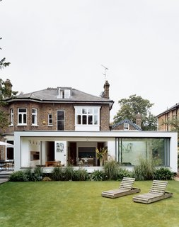 """New residential buildings are few and far between in England, so architects like Phillips have increasingly been charged with creating groundbreaking modern environments within the shells of historic houses. """"People just find it easier to work within existing houses to transform them to be sleek, stylish and functional,"""" says Phillips. """"Extensions have almost become a requirement for any homeowner who wants to be a part of modern living within the U.K."""""""