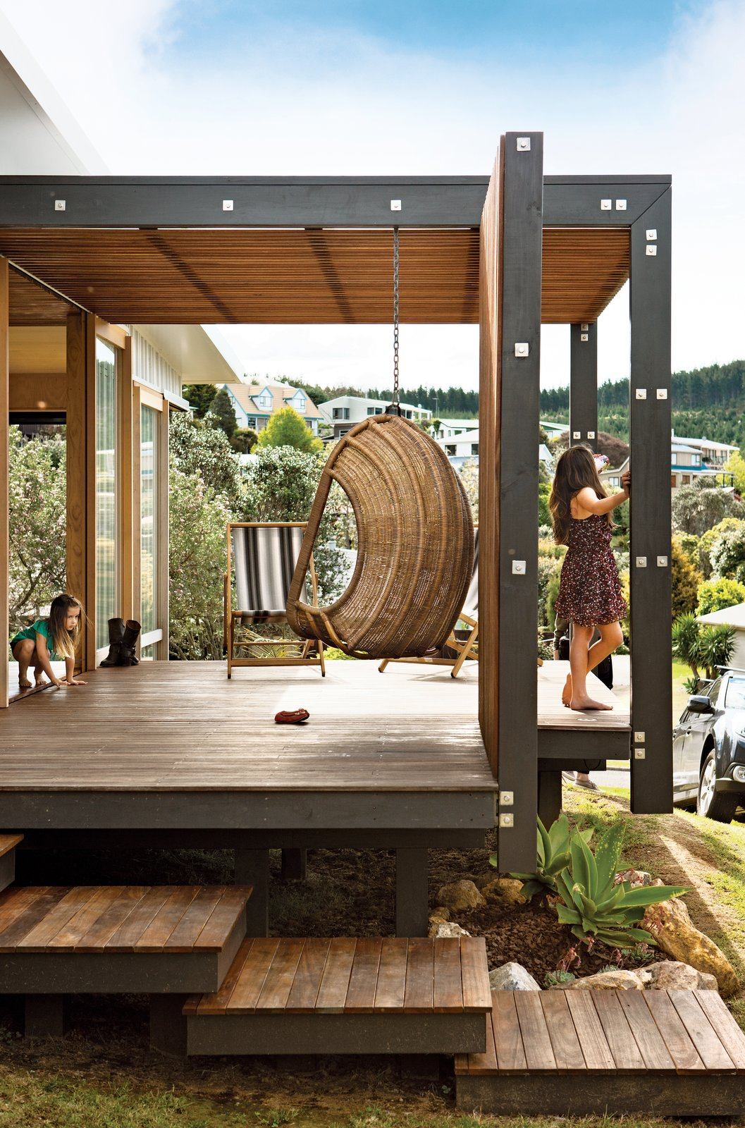 The topography proved challenging so the designers elevated the house on piers.  New Zealand Getaways by Andrea Smith from A Compact Prefab Vacation Home