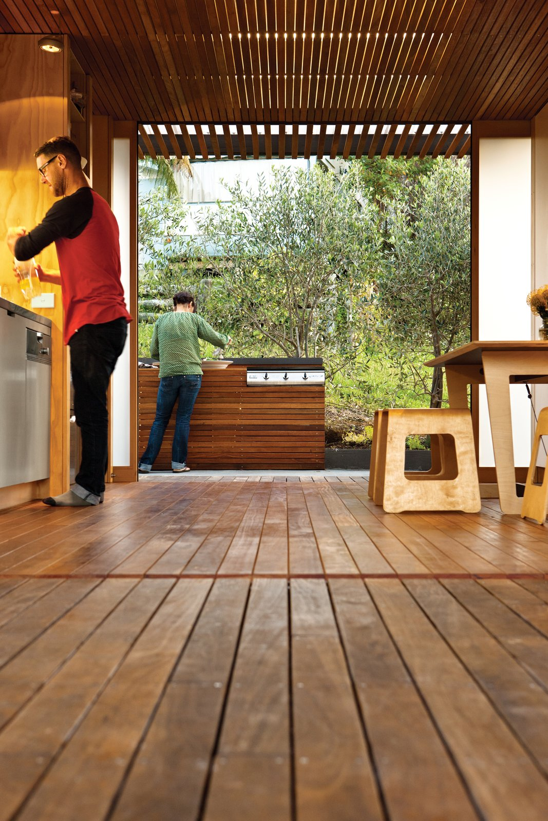 Eucalyptus is used for the kitchen floor and ceiling slats.  Photo 6 of 7 in A Compact Prefab Vacation Home