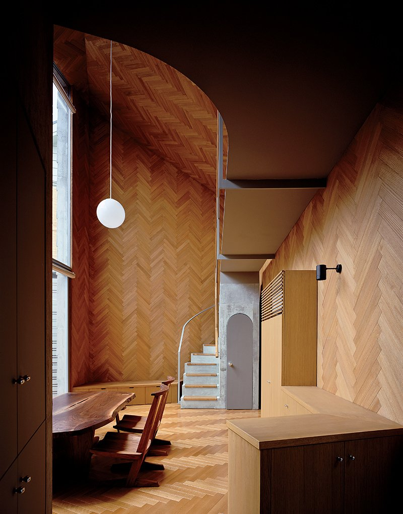 "Living Room, Ceiling Lighting, Pendant Lighting, Chair, and Medium Hardwood Floor Masahiro and Mao Harada of Mount Fuji Architects Studio wanted to break with the traditional definition of a house when they designed this small Tokyo home. They achieved their goal by using the same material for the ceiling, the walls, and the floor, creating a space that flows beautifully.   Photo by Ryota Atarashi.  Search ""tokyo landmarks architectural print unframed"" from Compact Wooden Home in Japan"