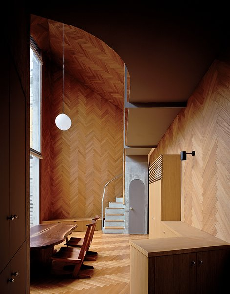 Masahiro and Mao Harada of Mount Fuji Architects Studio wanted to break with the traditional definition of a house when they designed this small Tokyo home. They achieved their goal by using the same material for the ceiling, the walls, and the floor, creating a space that flows beautifully.   Photo by Ryota Atarashi.