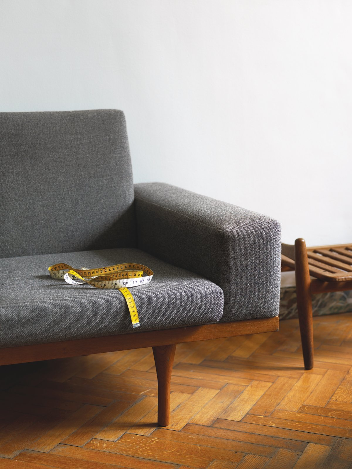 Living Room, Sofa, and Medium Hardwood Floor A 1959 teak-framed nine-foot-long SW 50-4 sofa by Illum Wikkelsø for the Danish furniture company Søren Willadsen sits pretty.  100+ Best Modern Seating Designs from A Neoclassical Gallery Home in Belgium