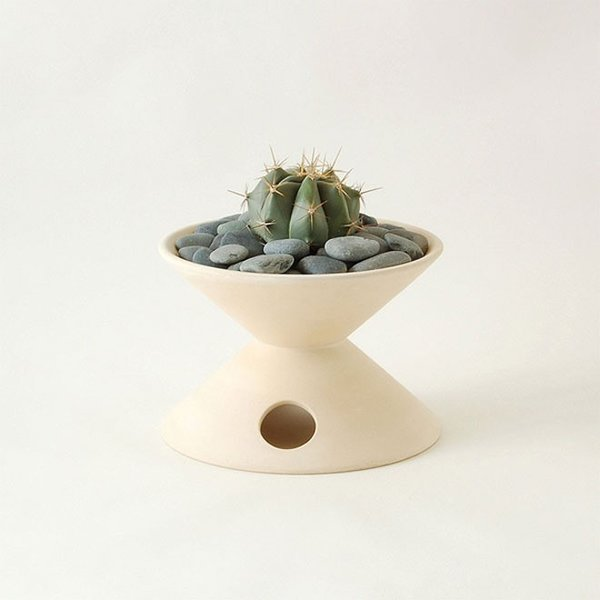 A cactus sits nicely in this fired-clay vessel from La Gardo Tackett.