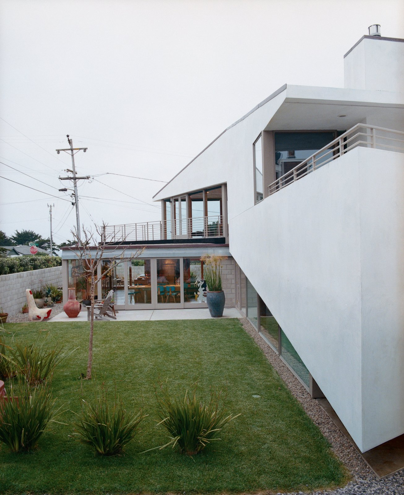 Grass, Back Yard, and Exterior In Montara, California, architect Michael Maltzan designed a home for, his sister and   brother-in-law. From certain vantage points, the home's unique angles result in M.C. Escher–like optical illusions.  Photos from The Full Montara