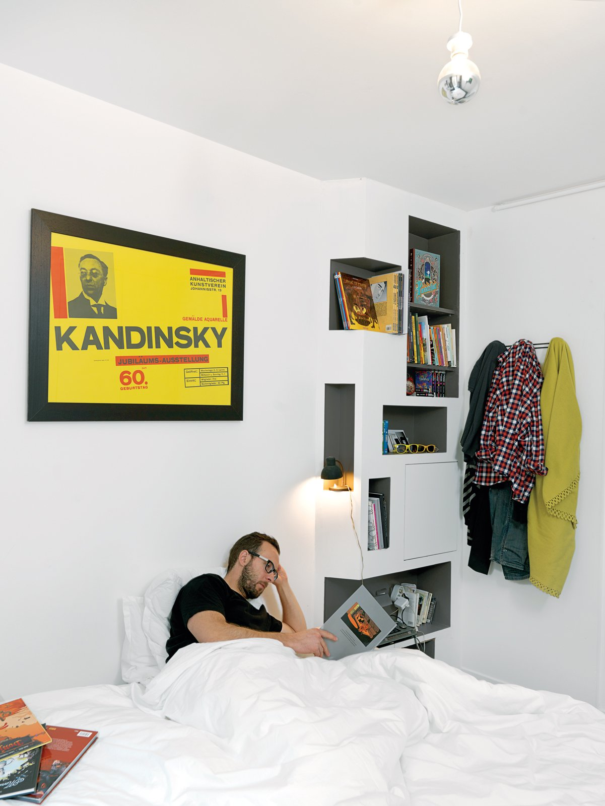 Bedroom, Bed, Bookcase, Storage, Shelves, and Pendant Lighting By the bed, the shelving pattern is meant to suit Vinciguerra's tendency to read several comics and graphic novels at once.  Best Photos from Shelf Life