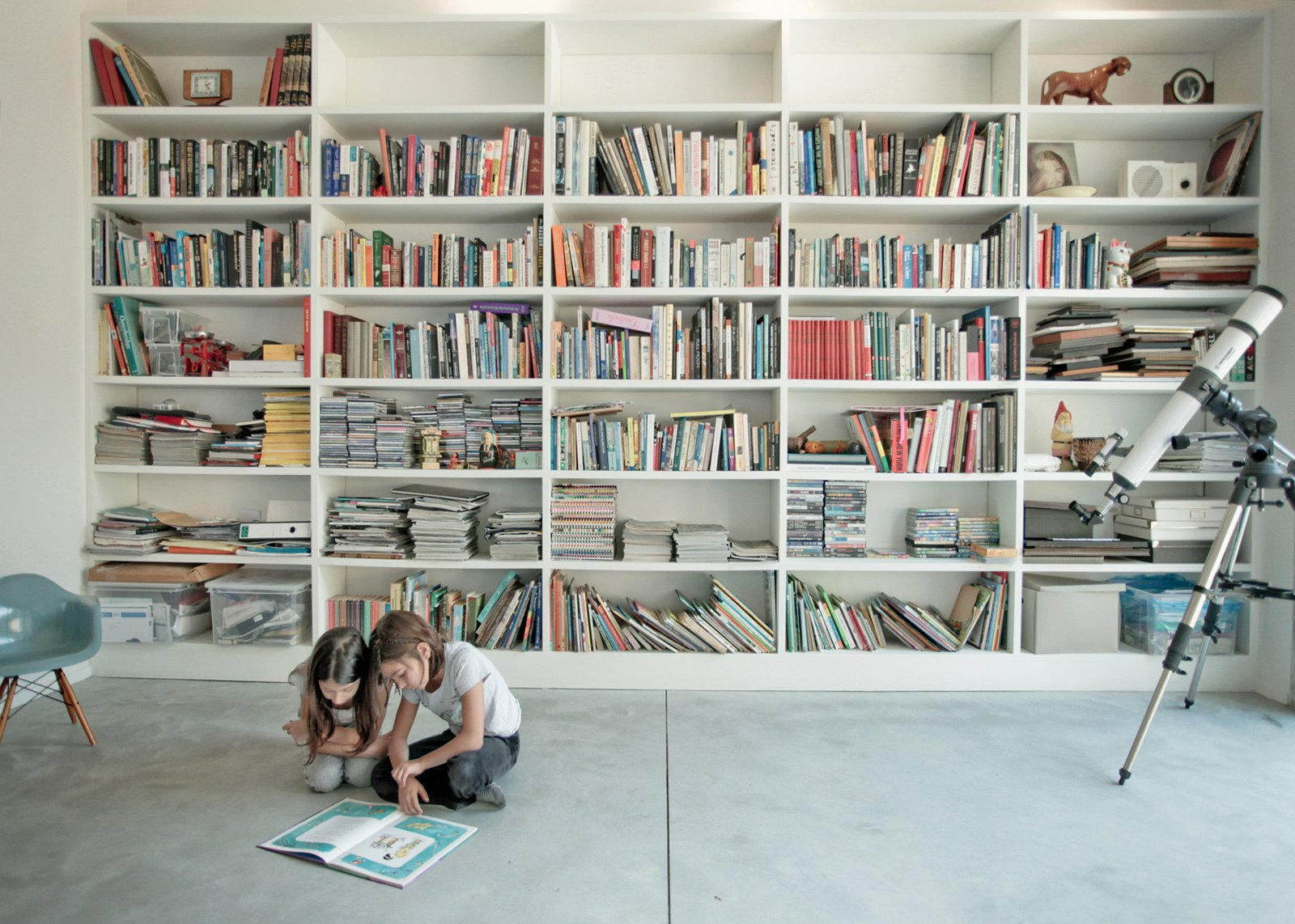 One wall of the living room houses a library.  Photo 1 of 1 in Gift Guide: 10 Books to Add to the Design Lover's Library from Inventive Modern Houses in Israel