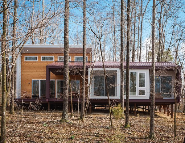 """Cement panels painted a plum hue clad Jason Gordon's 1,157-square-foot cabin in the Ozark Mountains. Architect German Brun and partner Lizmarie Esparza originally specified wood, but opted for the much less expensive material from James Hardie after contractor Damian Fitzpatrick recommended it. """"It was an exercise in cost engineering,"""" Brun says."""