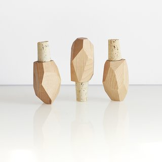 Bottle Rocks by Brush Factory. The cork stopper's black walnut or maple wood tops are modeled after stones, and no two are exactly alike. Made in Cincinnati, Ohio.