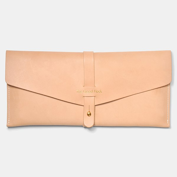 Travel Wallet by the Good Flock. Stow your travel trappings—like passports, boarding passes, and cash—in this vegetable-tanned leather pouch designed and made in Portland, Oregon.