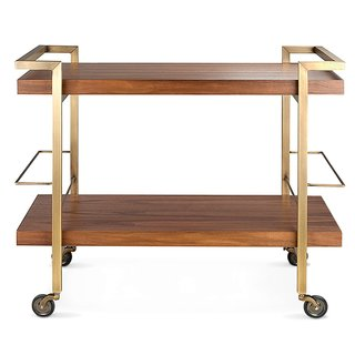 Driscoll Bar Cart by Frank Carfaro for Desiron. The New York-made walnut bar cart has a hand-welded brass frame that nods to swinging midcentury cocktail hours.
